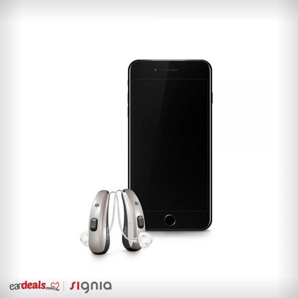 An iPhone and a pair of Signia Siemens Pure Charge&Go 7Nx hearing aids stand upright in the middle of a white background.