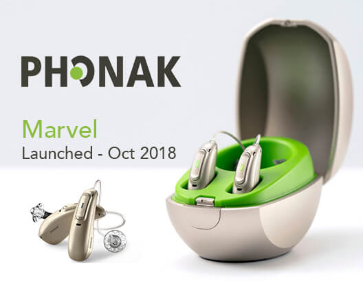 Phonak Audeo Marvel Hearing Aid recahrgeable devices sit beside each other with one pair on its charging case