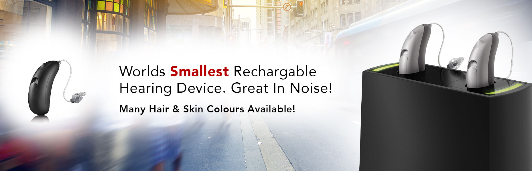 A pair of Moxi Fit R hearing aids on a charging case sits on the right side of a busy city-like background scenario and a single device on the other side of the image with a text in the middle that says World's Smallest Rechargeable Hearing Device. Great In Noise!