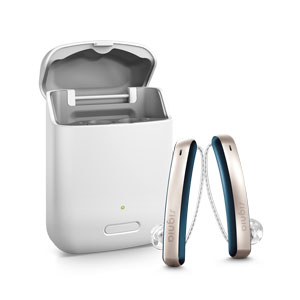 A pair of Signia Styletto Connect 7Nx hearing aid in comic blue and rose gold colour sits beside the charging case on white background