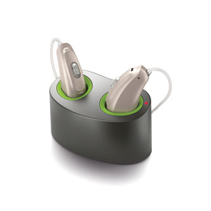 an image of the Phonak Audeo BR b90 hearing aid on the Mini Charger seated on a white surface